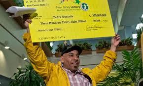 Quezada receiving his yellow lottery check