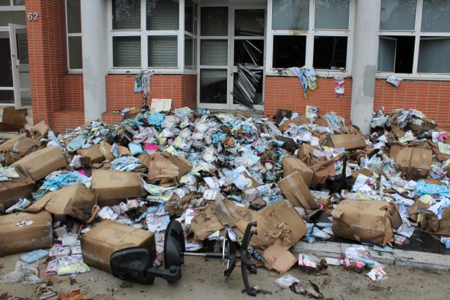 Debris outside of Charlie Hebdo's office after the November 2011 attack.