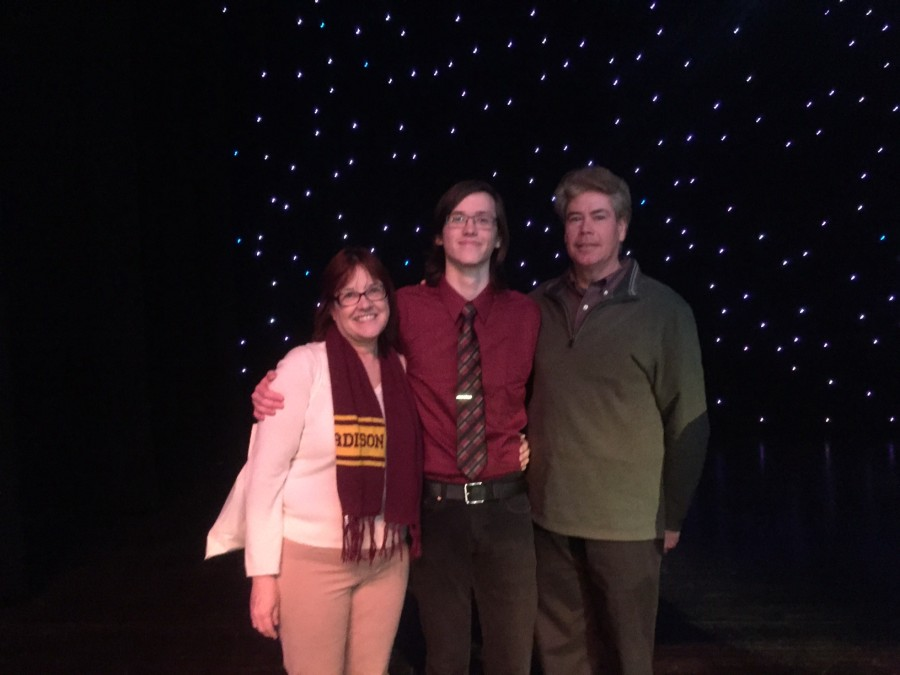 Denny Harrington with his parents at the regional-level Poetry Out Loud competition.