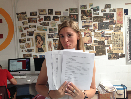 Overwhelmed student holding review packets