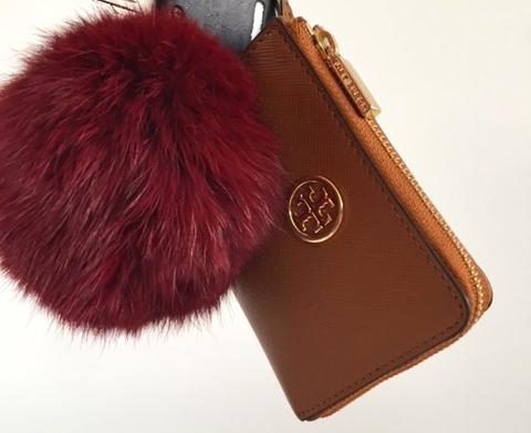 The fur pom pom is this winter's accessory trend.