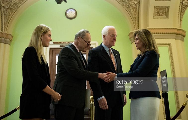 Kaitlyn Strada with her mother, Terry Strada and Senator Chuck Schumer and Senator John Cornyn