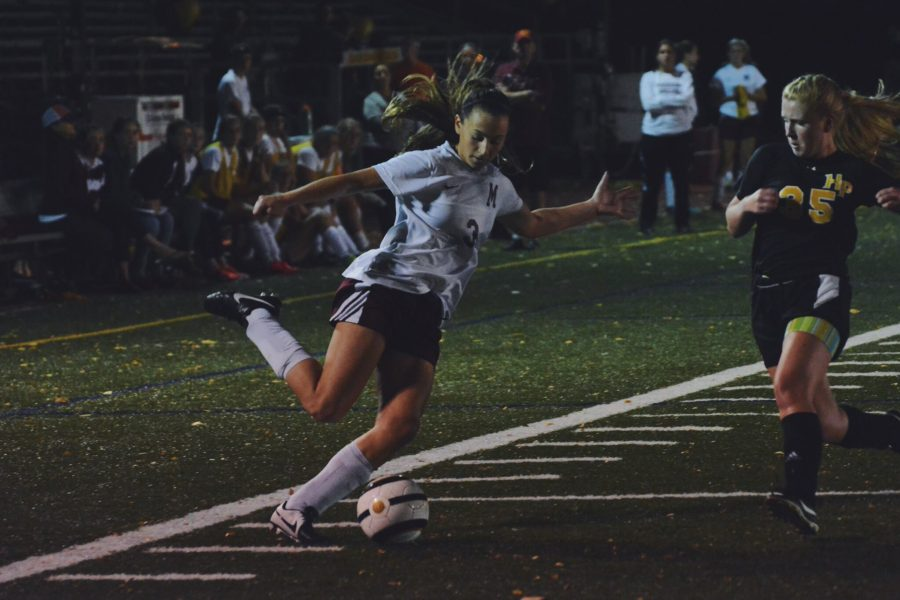 Senior, Ali Waxgiser, firing a ball past her opponent