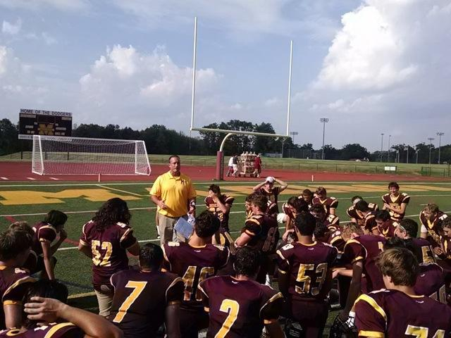 Coach Kubik talks to the football team after their win against Lenape Valley