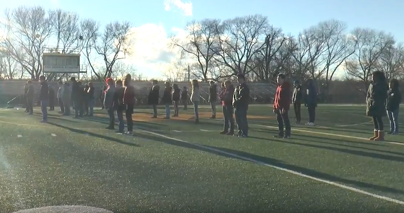 Students line up on the football field for the Privilege Test