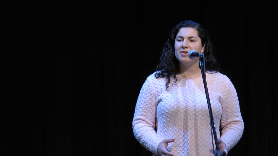 Mitra Sharif reciting her poem at the school wide Poetry Out Loud competition.