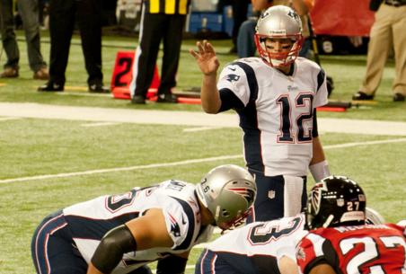 Tom Brady leading his team to victory