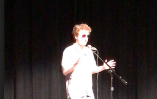 James Ottomanelli performs stand up comedy at the Talent Show