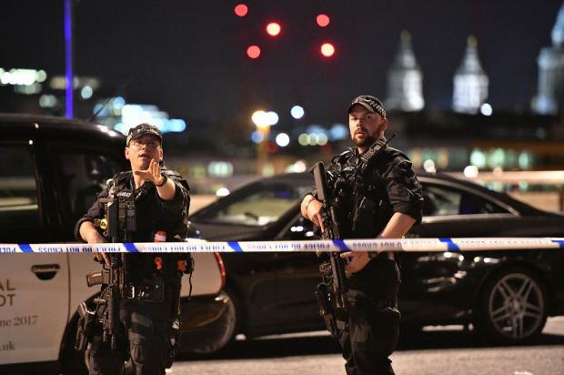 Police stand guard after London attack