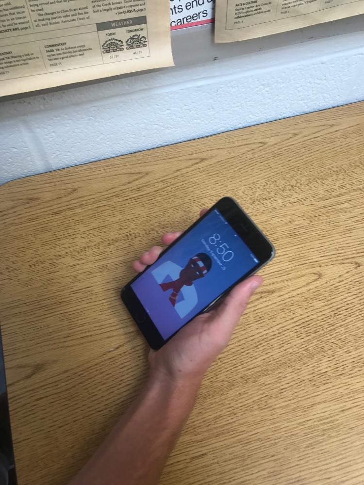 Senior Mike Quinn admires his Frank Ocean iPhone lockscreen