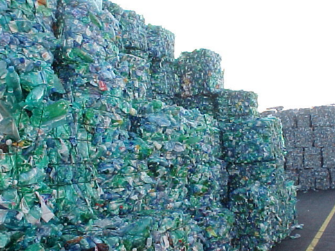Stacks and stacks of crushed plastic bottles and cans
