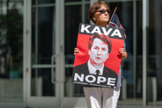 Woman stands in protest of Supreme Court Nominee Brett Kavanaugh (Google Common License)