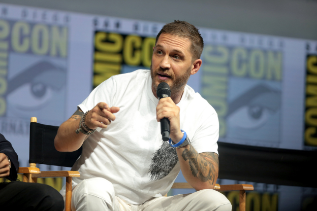 Google Common Licence -- Tom Hardy, who plays Eddie Brock in Venom, speaks at the 2018 San Diego Comic Con.